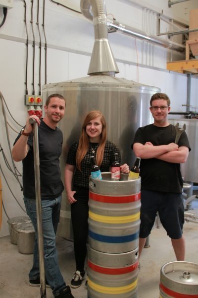 The team of craft brewers in the brewery